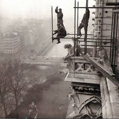PARIS - 1800-1940  Installing Scaffolding at Notre Dame. Paris 1952, a dizzying view to the three workers who were shielded gargoyles to secure the scaffold.