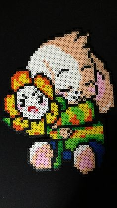 """Asriel from undertale. Measures approx 12"""" made from perler beads."""