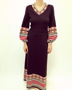 amazing vintage 70s knit maxi dress in black. poet sleeves. high waist and zips down the back. aside from minor signs of wear, great vintage condition. feels like a soft acrylic. approximate size small; please refer to measurements. length // 56 bust // 34 (unstretched) empire waist // 26 (unstretched)