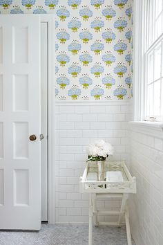 Pretty, fresh and clean - all the attributes of a summer house style bathroom (Design by Amie Corley Interiors)