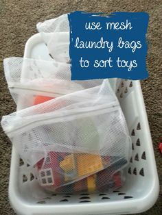 Use mesh laundry bags to organize toys.  Kids can see what is inside before dumping out a huge bin. With sets organized together (trains, lego, animals) it's much easier to grab something and play!