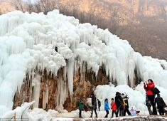 Incredible photographs show a waterfall in China FROZEN into thousands of icicles after temperatures plummeted to -12 degrees  Read more: http://www.dailymail.co.uk/travel/travel_news/article-3383589/Incredible-photographs-waterfall-China-FROZEN-thousands-icicles-temperatures-plummeted-12-degrees.
