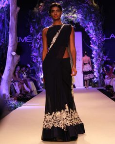 Navy blue georgette stitched sari with offwhite resham work teamed with a blue georgette blouse
