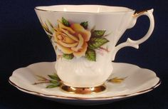 "This is a beautiful royal albert cup and saucer marked bone china england and is from the sweetheart roses series and is called ""rosemary. This beautiful set is deep yellow shaded roses and buds on a white background."