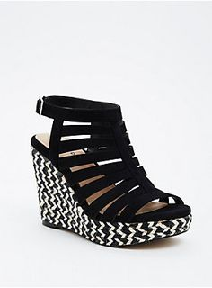 """The perfect warm-weather-wedge to go with your beachy maxi dresses. The stacked platforms get a major eye-catching boost with black and white chevron twine. The strappy cage front reigns in the look ever so slightly with sleek black faux suede.<div><ul><li style=""""list-style-position: inside !important; list-style-type: disc !important"""">TRUE WIDE WIDTH: Designed so you never have to size up again. For the perfect fit, we recommend going down a whole size.</li><li style=""""list-style-position…"""