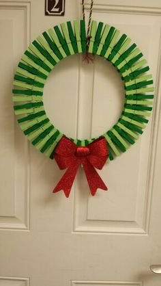 Remember the patriotic clothespin wreath? I dolled it up for Christmas!
