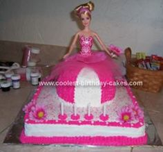Homemade Barbie Birthday Cake: This Barbie birthday cake is a very easy cake to do! Base is a 12 x 12 and Barbie's skirt was baked in the Pampered Chef 2 qt batter bowl. I made the icing