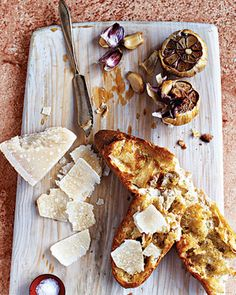 Once the garlic has been roasted, guests can squeeze the cloves directly onto a piece of crusty baguette and spread them like butter. Serve the baguette with shavings of Parmesan on the side.