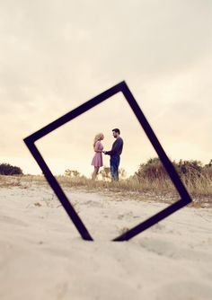 save the date / engagement picture ideas LOVE the frame, LOVE the sand, LOVE that it's at an angle :)