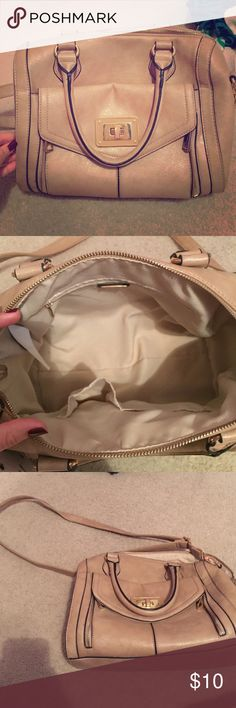 Nude purse Very spacious! Can be worn as a cross body or carried! Bought it and just never used it Bags