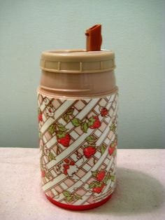 80s Strawberry Shortcake thermos. I had this exact one in kindergarten, and the lunchbox to go with it.