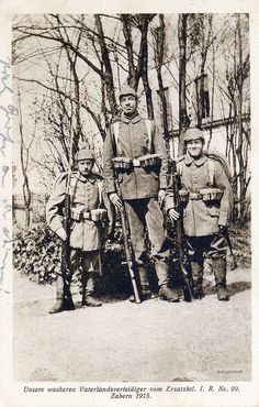 That is one tall soldier... or else two really short ones...  1915.