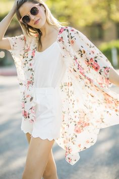 A girl can never have too many floral kimonos, especially when they're as gorgeous as this one! We're obsesed with the versatile ivory floral print of this feminine cover-up! This Spring must-have is