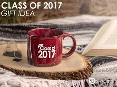 "Here's a perfect and practical gift for your special graduate of 2017. This 13 oz. Maroon ceramic camper style mug has ""Class of 2017"" printed in white on both sides of the mug."