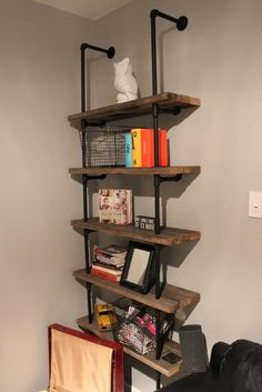 Iron pipe bookshelf for bedroom.  Improve design using 2x10 or 1x10 weathered wood or barnwood