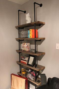Iron pipe bookshelf for bedroom.  Improve design using 2x10 or 1x10 weathered wood or barnwood