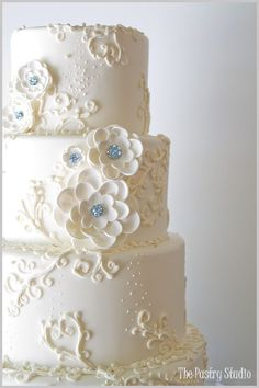 A Glamorous Wedding Cake with hand made sugar-paste flowers using Swarovski Crystals in teal. » The Pastry Studio #purpleweddingcakes