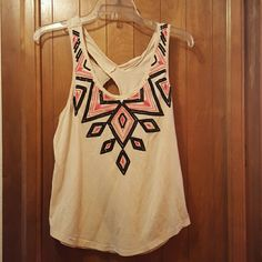 Tank with rad back! Cute cream aztex tank top! Wore once, cream isn't my color sadly. Urban Outfitters Tops Tank Tops