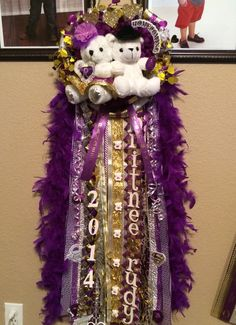 Triple flower homecoming mum. Double bears. Purple gold and white (made by me)