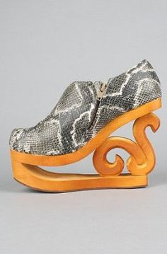 I like the woodwork on the heel, but I'd never wear this. They almost belong in on my Funny board.