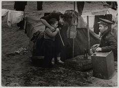[Woman, man and child at a concentration camp for Spanish refugees, Argelès-sur-Mer, France]