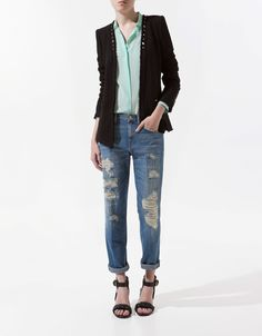 I love shredded jeans; great relaxed styling with the knit chanel-like studded jacket