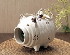 Kayaributa (蚊遣豚), blog.gaijinpot: This cute ceramic pig holds a mosquito coil (an incense stick that contains insecticide.)  When burned, the smoke curls out of the pig's nose.  #Mosquito_Coil #Japan