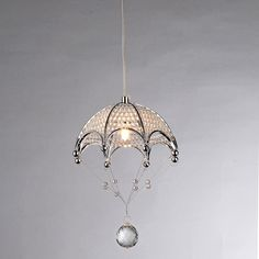 Sparkling light and modern design combine in this stunning chandelier. The chrome fixture features an umbrella design adorned with delicate crystals that catch the light, making the piece perfect for a foyer or dining room.