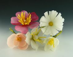 Crepe paper flowers dipped in wax to give them translucency