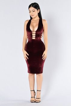 - Available in Burgundy and Silver - Velvet Midi Dress - Sleeveless - Deep V Neckline - Cut Out Sides - Strap Side and Chest Design - Lined - Made in USA - 90% Polyester 10% Spandex