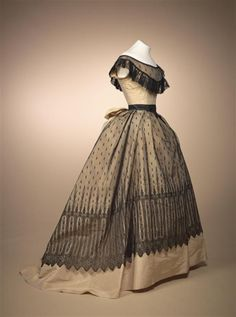 1868. Ball-dress of champagne gros de tours and Chantilly lace. From the Gemeente Museum den Haag, but the origin of the dress may be France.