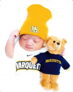 Mariah Tiana, born 10/10/12 to Domonique Miller, Comm '11, shows off her Marquette pride.