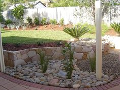 curved edge of yard river rock landscaping ideas - Google Search
