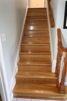 This set of oak stairs was worn and very 1970's golden oak colored. Stairs like this can easily be painted and install a stair runner for a modern update. - Thrift Diving Stairwell Wall, Stair Runner Installation, Stairs Colours, Staircase Landing, Oak Stairs, Staircase Makeover, Modern Stairs, Oak Color, Golden Oak
