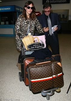 62afb7872cf9 Alexa Chung arrived at LAX airport looking fresh faced and sporting  personalized Louis Vuitton luggage Airport