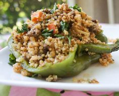 Quinoa & Ground Turkey Stuffed Peppers 1 Tablespoon olive oil (omit for phase 1) ½ cup chopped onion ½ cup diced carrot 3 garlic cloves, minced 1 lb lean ground turkey ½ tsp salt ¼ tsp ground black pepper 1 tsp garlic powder 2 Tablespoons chopped fresh parsley ¼ cup tomato sauce 2 large bell peppers, washed 2 cup cooked quinoa ½ chicken broth