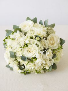 All Dressed in White: Flower Arrangements for a Winter Wonderland Wedding: These romantic wedding arrangements are deliberately formal, with a twist: a mass of tiny frosted pearls are hidden in the boutonniere and bouquet. Winter Wedding Flowers, White Wedding Bouquets, Flower Bouquet Wedding, Bridal Bouquets, Purple Bouquets, Flower Bouquets, Winter Weddings, Purple Wedding, Bridesmaid Bouquets