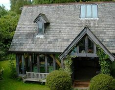 This beautiful oak frame barn conversion with arch-braced collar trusses, is in Devon, England. Seagull House was designed by architect Roderick James