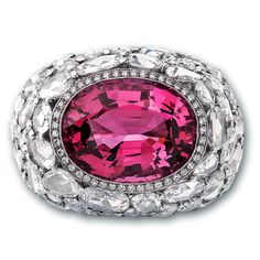 Burmese Spinel Cocktail Ring  The bright pink center Spinel stone of this magnificent ring is a delightful example of the fire and beauty for which Spinel's are desired. The fire and light of the lovely Spinel is complimented by a ring of rose cut White Diamonds.Jacob & Co. | Timepieces | Fine Jewelry | Engagement Rings