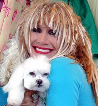 Betsy Johnson and her baby maltese.