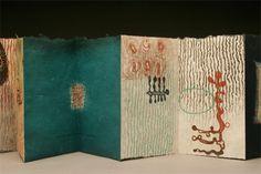 "Small GIfts by Karen Kunc. 2004. Bookwork: etching, letterpress. Text is a Finnish folk song. 5.5 x 3.5"" (5.5 x 60"" unfolded)"