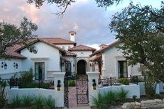 wrought iron fence panels Exterior Mediterranean with arched door archway clay tile roof cupola lanterns orange