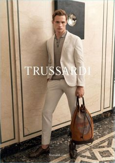 Julian Schneyder dons neutral suiting with a polo for Trussardi's spring-summer 2017 campaign.