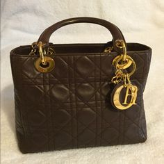 "Christian Dior Brown Lamb Skin LADY DIOR Cannage Hand bag: L: 9.44"" (24cm) H: 7.08"" (18cm) W: 3.54"" (9cm) Strap: N/A Made In: Italy Color: Dark Brown( chocolate brown) Condition: Corners/ Edges: Wear, partial rubs, and discolorations especially  on its top edge . Handles/Strap: sign of wear but no major damages.  Hardware: Sign of wear but no major damages. Lining: Some sign of wear but no major damages. Please Note, No strap comes with this bag. Christian Dior Bags Satchels"