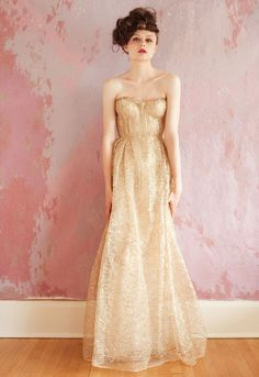 Sarah Seven - Bridal 2013 - Gorgeous spun gold dress with a nod to vintage, but with a modern twist. I love the strapless and body-hugging top and slight mermaid bottom.