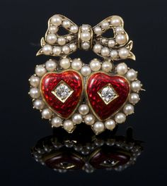 A late Victorian gold and red-guilloche-enamel double-heart brooch, with two red-guilloche-enamel hearts, each set with an old-cut diamond, surrounded by a border of seed pearls with a seed-pearl ribbon-bow surmount.  (Reeman Dansie)
