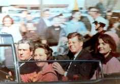 Amateur snapshot, made with Kodak Brownie camera, of Kennedys and Connallys in the motorcade about two minutes before the shooting in Dealey Plaza. Photographer unknown