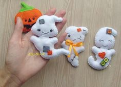 Boo! This listing is for halloween ornaments set - 3 very sweet and not so scary ghost ornaments and 1 pumpkin. Please choose from the dropping menu the way of finish: toys only, hanging ornaments set or magnets. The little ghost measures approx. 10 cm. Toys are totally hand made: hand cut and hand sewn of wool blended soft felt, lightly stuffed with non-allergenic hollofayber. This is just an adorable ornament to hang anywhere for the Fall and Halloween season and would also make a lovely…