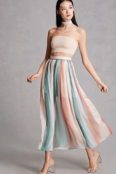 A nylon maxi skirt by Blush Noir™ featuring a tie-dye design, soft accordion pleats, and a concealed side zipper.