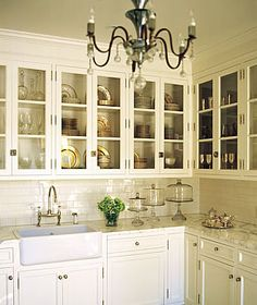 I love the look of glass front cabinets, and would love stacking all of my white dishes just so...
